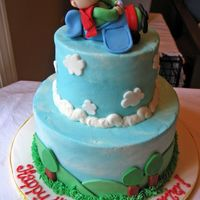 Airplane   Frosted in buttercream with fondant accents. All the credit for the idea of the plane and boy goes to bmote1!