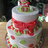 Christmas Elf   Buttercream with fondant accents. Elf sculpted from fondant. I had a lot of inspiration from other elf cakes on this site!