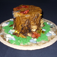 Tree Stump One of my entries for the Queen City Cake Show last weekend. It won second place. Most of it is fondant. The butterfly was drawn on rice...