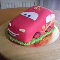 Lightning Mcqueen Vanilla sponge cake filled with caramel mousse and banana whipped cream. Covered in and decorated in sugar paste. I didn't have time...