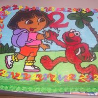 Dora/elmo Birthday Cake My daughter shared her birthday party with her friend. She is a Dora fan and he is an Elmo fan. This is a FBCT for their 2nd birthday.