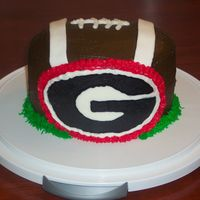 Georgia Football Cake Made this for my bro-in-law's birthday. He's a Georgia football fan. I used the two oval pans, stacked, and carved the top to...