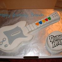 Guitar Hero Cake guitar hero cake for a friends birthday. it was fun to make.