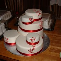 Dscf0004.jpg Round wedding cakes with ribbon and royal icing decoration. Dummy cake covered in fondant for fourth of july wedding