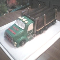 Logging Truck For An 11 Year Old Boy the cake is tahitian vanilla flavoring pound cake from scratch. crumbcoated with buttercream with butter/vanilla flavoring- fondant is mmf...