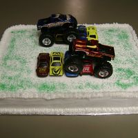 Monster Truck Cake Used real toys cars and green sprinkles for grass.