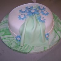 Fondant Cake Made this in the Wilton 4 Course. This was done in our 2nd lesson. We worked on draping and gumpaste flowers.