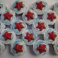 Patriotic Cupcakes All I did was swirl on the buttercream icing added blue sprinkles and placed candy stars made with Wilton Candy Melts. Simple, easy and...