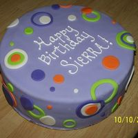 Birthday Cake Covered in fondant with fondant circles.