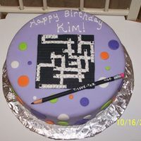 Crossword Puzzle Crossword puzzle and pencil made with fondant, cake also covered in fondant.