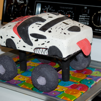 Monster Truck Cake 2 2nd attempt at a monster truck cake. It went alot better than my 1st attempt and my 5 year old loved it!