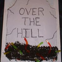 Over The Hill Loved the way this cake turned out. The plan was to make it more like one I saw on here, but once I just put the light gray icing on, I...