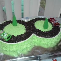 "Steph's ""cars"" Race Cake  Here is another cake that my daughter did for my grandson's birthday. He loved it! Road was made from crushed oreo cookies. Cars were..."