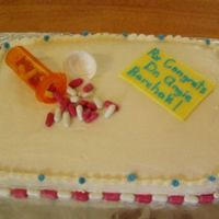 Pharmacist Cake I made this cake for my cousin who just recieved her doctorite and isaccepting a pharmacist position locally. Most is done with buttercream...
