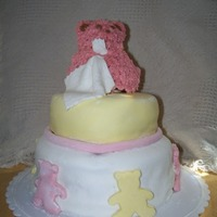 Shower Cake Round layer shower cake covered in MMF. Bear done in buttercream