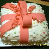 Foral Fondant Present Cake   This is a class cake. All decoration was done in fondant.