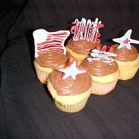 Memorial Day Cupcakes White cupcakes with chocolate icing and chocolate decorations on top.