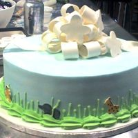Veronica buttercream iced with fondant accents