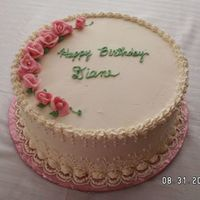 "Ladies Birthday Cake 10"" round, iced in IMBC with piped side embroidery and pink roses."