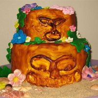 Tiki Cake   The Tikis are carved cake covered in fondant and painted, the flowers are all foundant