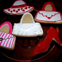 Girly Cookies  Suage Cookies - Shoe is red fondant with textured roller and flower cut out; purse is royal icing with food color pens; rest colored royal...