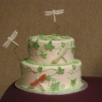 Dragonfly Cake Fondant covering (over cake dummy) and fondant leaves with royal icing ivyChocolate dragonflys (from mold) with shimmer dust. Made at Cake...
