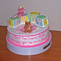 Baby Shower - Girl And Bear With Blocks  My first fondant figures!! It is a 12 inch white cake with lemon cured filling and butter cream frosting. The blocks are cake covered in...