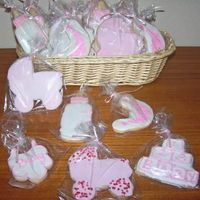 Baby_Shower_Cookies.jpg No Fail Cookies and Royal Icing made for a baby shower. The pram has pink sandy sugar or small hearts and the moon is stamped on to the...