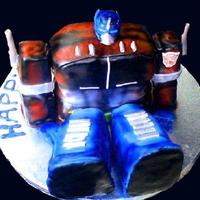 Optimus Prime Cake   Rainbow Vanilla cake w/ banana cream filling fondant covered