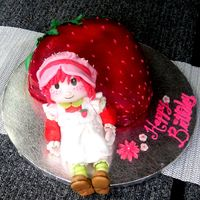Strawberry Shortcake Cake Golden vanilla cake w/fresh made strawberry preserves filling.Vanilla BC. Figure is made from RKT and gumpaste. TFL
