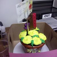Mother's Day Yellow Mini Cupcake Bouquet This is my first attempt at make one, my daughter helped me with making the chocolate suckers. I made about six pots for a couple of mother...