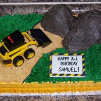 Construction Site W/ Tractor This cake was for a 2-year-old boy's birthday. As with most boys this age, he loves tractors. The tractor is a toy I bought at Target...