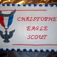 Eagle Scout lemon cake with lemon buttercream. Eagle scout medallion made out ofof gumpaste by my DH.