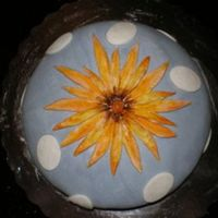 Smallflowercake.jpg A french vanilla kahlua cake iced in BC and covered in MMF. Accents and flowers made from MMF and hand painted flower.