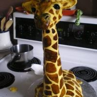Giraffe French Vanilla-Kahlua cake w/ mocha b/c filling, covered in fondant. Hand-painted, head and neck are carved styrofoam.