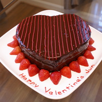2Nd Valentine's Day Cake Chocolate Cake filled with Chocolate Fudge and covered in Chocolate Glaze and Strawberries