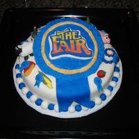 "Ny State Fair Entry The theme was ""The Fair."" RI logo (done like FBCT) with fondant figurines and blue ribbons. I won 5th place!"