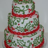 Holly And Swirls Freehand holly leaves and swirls in buttercream.