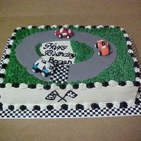 Nascar Birthday Birthday cake for a Nascar fan. White almond sour cream with buttercreme icing. Race cars are harder than the look to make. But I think the...