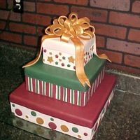 Christmas Gift Boxes  This is a dummy cake that I made for an event called A Taste of Cullman. My caterer friend (I rent kitchen space from her) has a table...
