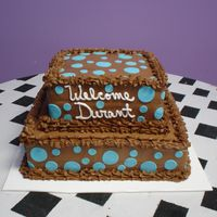 Brown & Blue Baby Shower Chocolate & white cake with chocolate buttercream. Dots are fondant.
