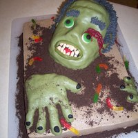 Zombie Rice krispy treat head and hands covered in fondant