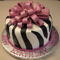 Happy Birthday All buttercream, with fondant bow and fondant zebra accents. This was one happy birthday girl!
