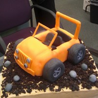 Jeep Cake The bottom was a sheet cae covered in buttercream and crumbled chocolate muffin. The Jeep was molded from rice crispies treats, frosted...