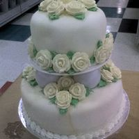Round Pillar Wedding Cake This cake was made with round pillar separators. The roses are royal icing, the icing is rolled marbelized fondant and the boarder is with...