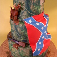 Camo Wedding Cake The bride herself called it her redneck wedding cake :) 6/8/10 inch cakes with fondant shotgun, leaves and flag, the deer was a model toy...