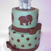 Elephant Baby Shower Cake Cake for a baby shower with elephant theme, their colors were chocolate brown and sage. Buttercream with fondant details, the elephant on...