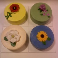 Four Favorite Flowers A shared birthday party and each one chose a different flower and flavor of cake. 6 inch cakes are icovered in buttercream and flowers are...