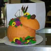 Pumpkin Vase Inspired Cake Pumkin is made out of 3, 8 inch layers with 6 inch lid shaved to give better shape. Flowers, indian corn and cattails are made from royal...