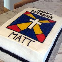 Happy Communion Matt Chocolate cake with milk chocolate filling. covered with butter cream.I used piping gel for the stain glass effect